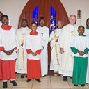 Photo taken before the start of the Annual Thanksgiving Day Mass in the back of St. Joseph Church. The Priests and Deacon in the picture (left to right) are Fr. John Mark, Fr. Boniface Blanchard M. Twaibu, Deacon Guillermo Huertas, Fr. E. Patrick Lynch, C.Ss.R. They are surrounded by the altar servers from the 3 schools. Not in the picture was Fr.Touchard Tignoua Goula who also concelebrated the Mass.